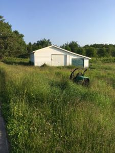 storage shed and lawn tractor